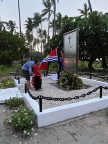 Family wreath laying